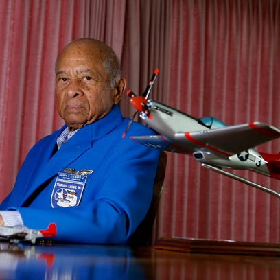 Tuskegee Airman Harry Stewart with a model of the P51