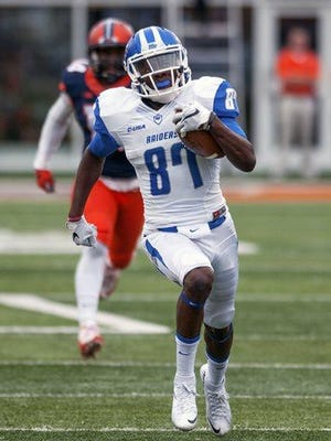 Middle Tennessee wide receiver Richie James (87) runs for a touchdown after a reception during the second quarter Saturday, Sept. 26, 2015, at Memorial Stadium in Champaign, Illinois.