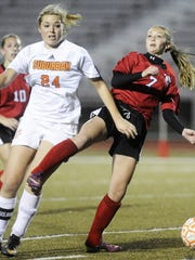 Dover's Brooke May, right, defends York Suburban's Lexi Ketterman two season ago in the spring. (DAILY RECORD/SUNDAY NEWS -- KATE PENN)