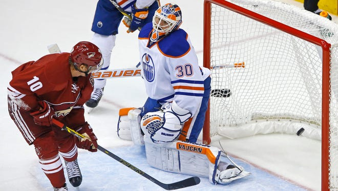 Arizona Coyotes left wing Martin Erat (10) beats Edmonton Oilers goalie Ben Scrivens (30) for a goal during the third period of their NHL game Wednesday, Oct. 15, 2014 in Glendale.