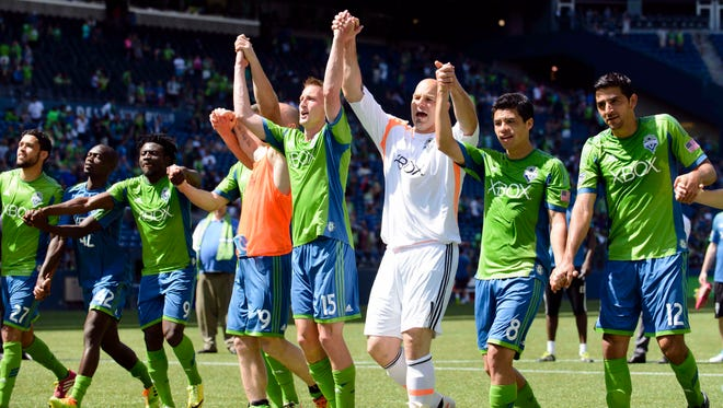 Sounders players celebrate after the win over Real Salt Lake.