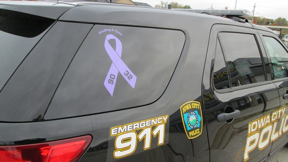 An Iowa City Police Department car is shown with a lavender ribbon to raise awareness of cancer.