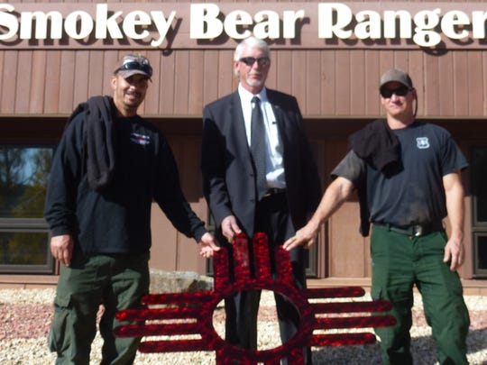 Carl Bartley, center, and district staff show off the
