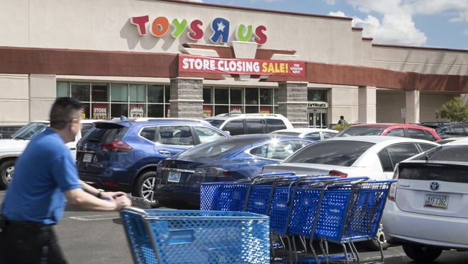 Toys R Us stores across the country are getting ready to close, as the company is expected to file for Chapter 7 bankruptcy liquidation. Shoppers head to a Phoenix Toys R Us storefront for store closing sales on March 11, 2018.