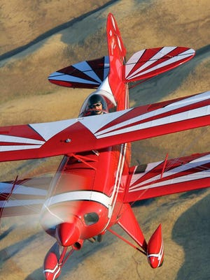 Yuichi Takagi zips across the south Salinas Valley skies in his Pitts aerobatic biplane. Takagi, a King City resident, will be appearing at the Salinas Airshow on Sept. 26-27.