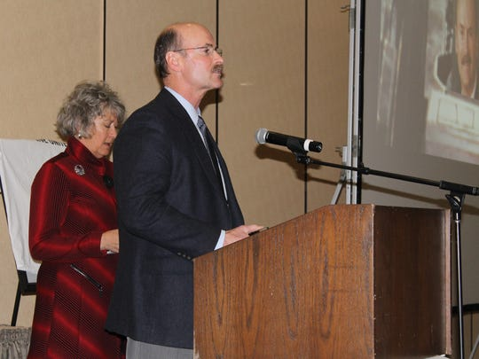 Jeff Martin of Ministry Health Care accepts the Tina Peters Dedicated Service Award presented to an individual who has shown exemplary passion and compassion to the residents of Portage County at United Way of Portage County's 2015 Recognition Luncheon Tuesday, Feb. 9, at the Holiday Inn in Stevens Point. Tina Peters (left) presented the award to Martin during the luncheon.