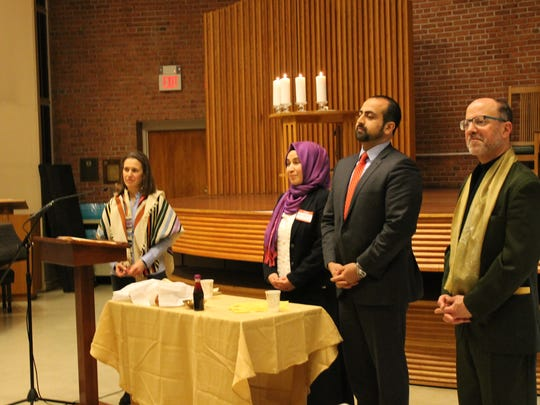 Rabbi Adina Lewittes, Peace Islands' Meryem Teke, speaker Umair Khan and the Rev. David Horst answer questions at a United Faiths of America event on Friday at Central Unitarian Church in Paramus.