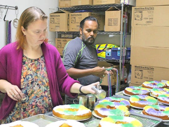 Lilah's Bakery owners Lisa and Sopan Tike decorate some of the 200 to 500 king cakes baked daily during Mardi Gras season.