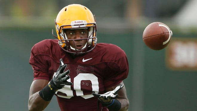 Arizona State wide receiver Ellis Jefferson eyes the football during practice on Monday, Aug. 19, 2013, in Tempe.
