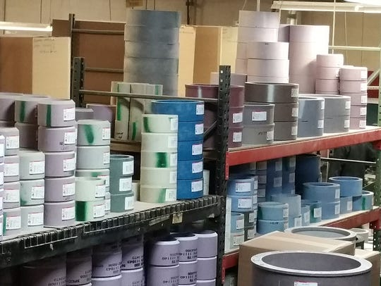Shelves of grinding wheels at Rochester Abrasives Industries,