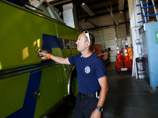 Lt. Jay Dollar, with San Juan County Fire Department District 6, inspects a fire truck on Monday at the Lee Acres fire department in Farmington.