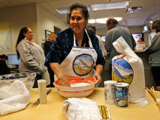 Patricia Whitehorse leads a frybread demonstration on Monday at San Juan College in Farmington.