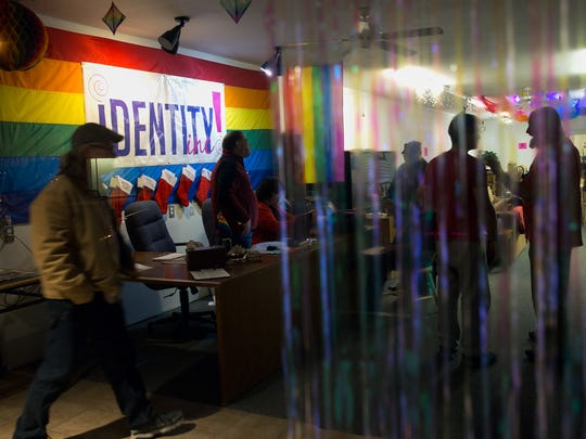 Community members gather for a meeting Wednesday at Identity Inc. in downtown Farmington.