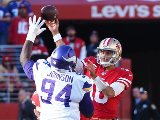 Jan 11, 2020; Santa Clara, California, USA; San Francisco 49ers quarterback Jimmy Garoppolo (10) throws under pressure from Minnesota Vikings defensive tackle Jaleel Johnson (94) during the first quarter in a NFC Divisional Round playoff football game at Levi's Stadium. Mandatory Credit: Kelley L Cox-USA TODAY Sports