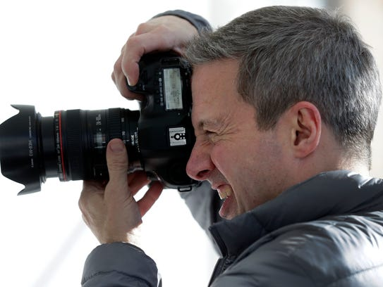 Photographer Rick Guidotti composes a portrait during
