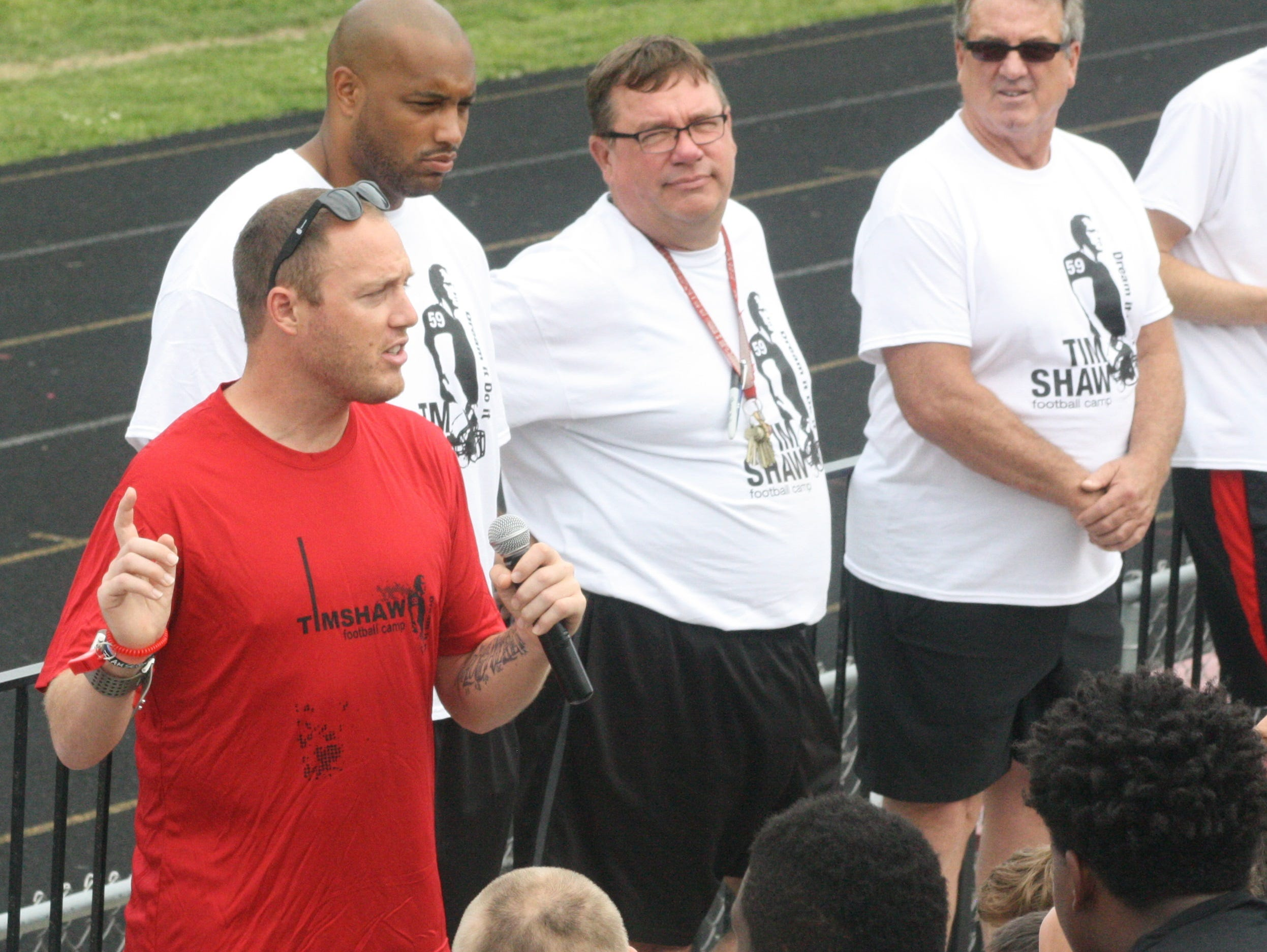 Tim Shaw delivered a stirring pep talk to the 200-plus participants at his sixth annual football camp Friday night.
