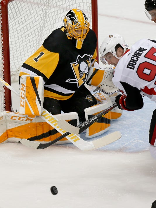 Pittsburgh Penguins goaltender Casey DeSmith (1) stops a shot by Ottawa Senators' Matt Duchene (95) during the first period of an NHL hockey game Friday, April 6, 2018, in Pittsburgh. The Penguins won 4-0. (AP Photo/Keith Srakocic)
