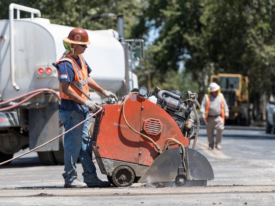 Crews continue work on the utility and street reconstruction