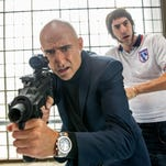 """Mark Strong and Sacha Baron Cohen star in """"The Brothers Grimsby."""""""