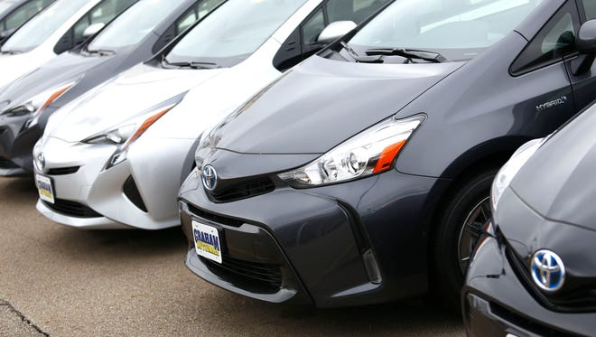 A line of Toyota Prii sit on the sales lot of the Graham Automat in Mansfield on Friday, April 8, 2016.