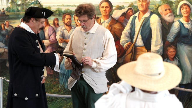 In 2013, Jim Viator, left, and Robert Landreneau perform in a vignette depicting an Acadian story and the people who lived through during The National Day of the Acadians at the Acadian Memorial in St. Martinville.