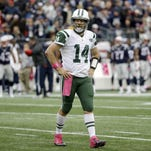New York Jets quarterback Ryan Fitzpatrick walks on the field during the first half of an NFL football game against the New England Patriots, Sunday, Oct. 25, 2015, in Foxborough, Mass. (AP Photo/Steven Senne)