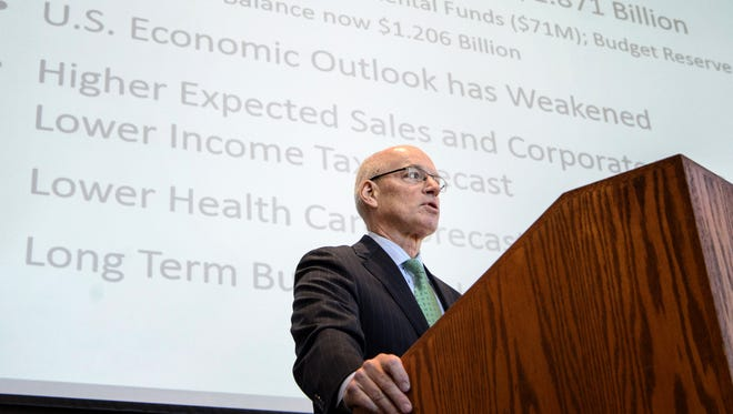 Minnesota Management and Budget Commissioner Myron Frans speaks about the state's projected budget surplus growing to $1.87 billion Thursday, Dec. 3, 2015, in St. Paul.