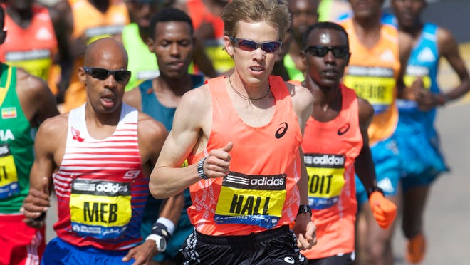 Elite runners Ryan Hall (middle), Josphat Boit (right) and Meb Keflezighi (left) race during the 2014 Boston Marathon.