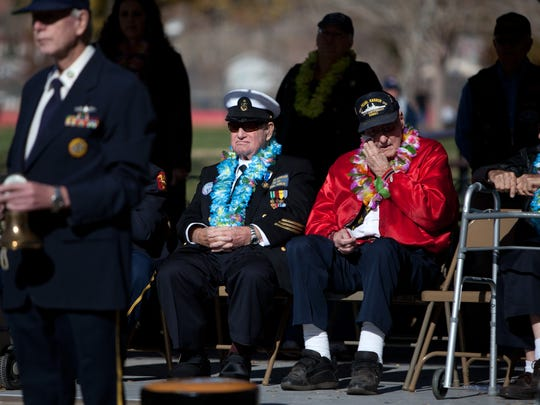 World War II veterans and Pearl Harbor survivors Lee Warren, left, and Garth Sawyers, right, listen while their fellow Pearl Harbor survivor Wardell Jenkins wipes away a tear and veterans Hal Hess and Milton Jacklim read the names of local Pearl Harbor survivors who have passed on and ring a ships bell in honor of the deceased in Vernon Worthen Park during a Pearl Harbor Day memorial remembrance ceremony Friday, Dec. 7, 2012 in St. George, Utah.