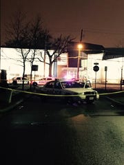 Police investigate a shooting in the West End Thursday.