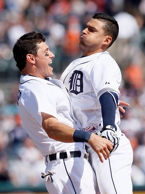 Jose Iglesias chest-bumps Ian Kinsler after hitting an RBI-single to defeated the White Sox in the ninth inning.