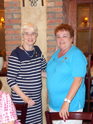 Carol Parks (left), outgoing president of the Woman's Club of Vineland, presents Norene Ritter with the Woman of the Year pin.