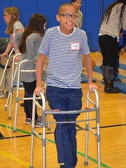 Fifth-grader Landon Tyler participates in MH Guest's Disability Awareness Workshop.