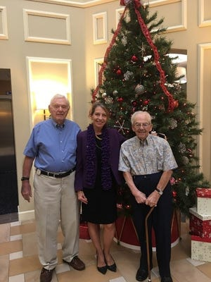 From left, Al Malley and Donna True, Program Services Coordinator with the Alzheimer's Association; appreciate the donation from Ed Harney, Allegro resident, right.