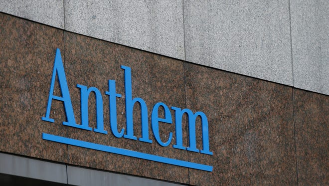 FILE - This Wednesday, Dec. 3, 2014 file photo shows the Anthem logo at the company's corporate headquarters in Indianapolis. Health insurer Anthem said in a statement Wednesday Feb. 4, 2015 hackers infiltrated its computer network and accessed a swathe of personal information about current and former customers including their incomes and street addresses. (AP Photo/Darron Cummings, File)