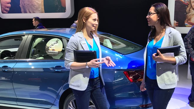 Volkswagen's product specialists at the 2018 Detroit auto show reflect a casual Friday look with their sweater blazers and Express jeans.