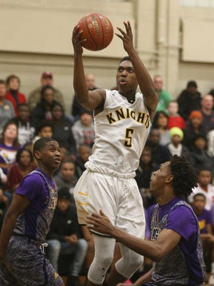 McQuaid's Thomas Jones, who scored a game-high 25 points, splits the East defense and drives to the basket.