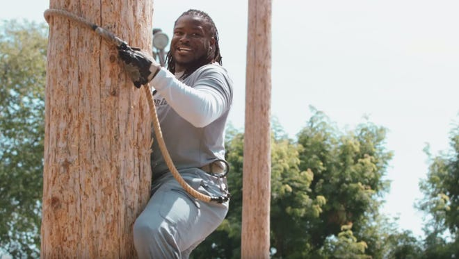 Eddie Lacy struggled to climb the tree with his 5-foot-11, 230-pound running back frame.