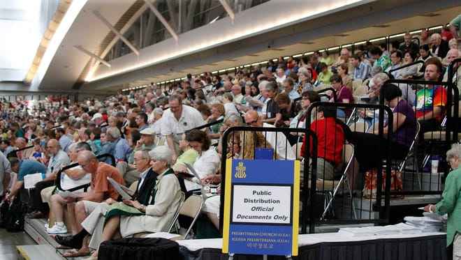 People listen to a session of the 220th General Assembly (2012) of the Presbyterian Church (USA) on in this July 5, 2012 file photo taken in Pittsburgh. The Presbyterian General Assembly, meeting in Detroit June 14-21, 2014, will consider withdrawing its investments from some companies whose products are used by the Israeli government in the Palestinian territories. Divestment advocates were narrowly outmaneuvered at the last Presbyterian convention in 2012, losing a crucial ballot by just two votes.