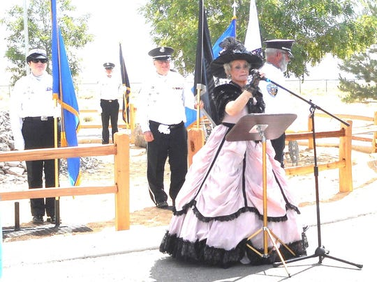 Country-western singer Lacy J. Dalton sings the National Anthem