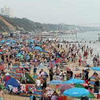 People gather on a public beach in Bournemouth, England, on Thursday. Europe overall is expected to see less tourism this year, but the United Kingdom is likely to outperform the rest of the continent after it left the European Union.