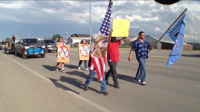 Opponents of open enrollment march down Main Street in Browning. The Blackfeet people remain divided over the proper role, if any, for blood quantum measurement.