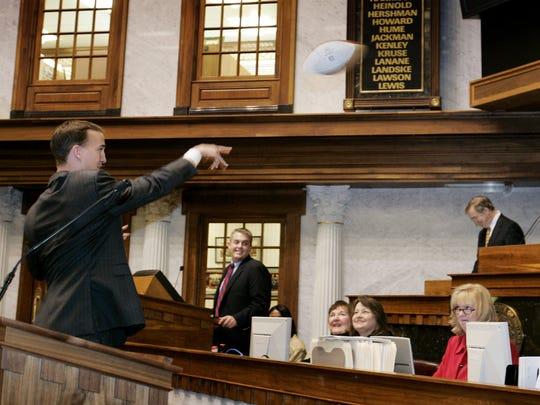 MANNING 108887 02/03/05 SAM RICHE / THE INDIANAPOLIS STAR:Colts' qb Peyton Manning, left, throws a pass to Bob Garton, R-Columbus and Senate Pro Temp, right, before addressing the Senate. Indianapolis Colt quarterback Peyton Manning was honored at both the Indiana House of Representatives and the Indiana Senate Thursday afternoon, January 3, 2005 at the Indiana State House in Indianapolis, IN. Manning was honored both for his play on the field this past year, breaking Dan Marino's td record, but also for his civic accomplishments here in Indianapolis.