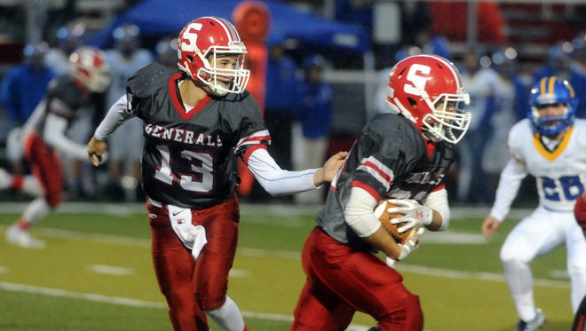 Sheridan's Dylan Dupler hands off to Luke Ridenour during the Generals 14-6 win over the Panthers during a 2015 game in Thornville. Both players have keyed the Generals' 2-0 start this season.