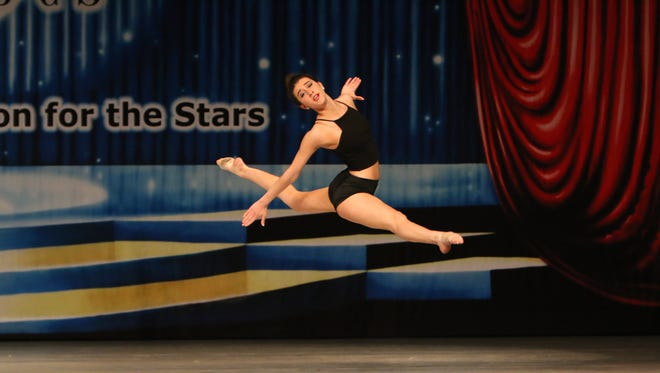 Elena Tiderencel dances at the Encore Dance Competition for the Stars in Rome, NY. Tiderencel's routine was choreographed by Dancescapes owner and instructor, Nichole Monico.