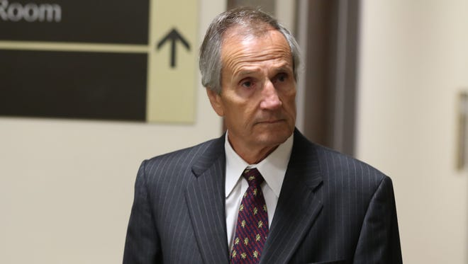Robert Wiesner, former security director at the Monroe County Water Authority and husband of former County Executive Maggie Brooks, enters court Tuesday morning.