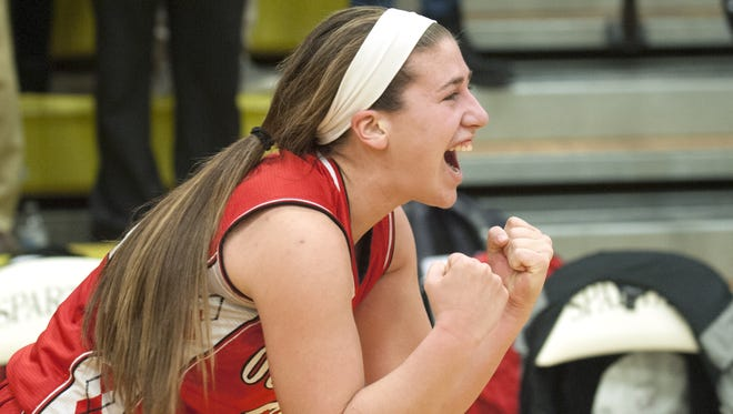 Ocean City's Grace Sacco celebrates Ocean City's 58-57 win over Ewing in the state Group 3 girls' basketball semifinal game played at Deptford High School on Thursday.