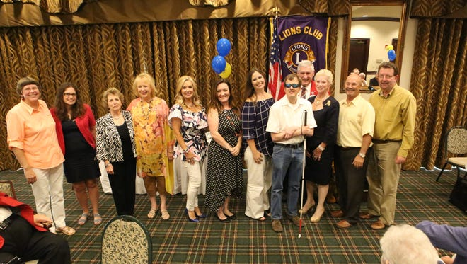 The Mountain Home Lions Club recently announced their 2017-18 officers at the annual Lions Club Banquet. New officers are: (from left) Jan Lowery, Lion-At-Large; Kelly Johnson and Robin Hawkins Board (Past President) Lucinda Blair, Lion Tamer; Brenda Allen, Membership Director; Jennifer Hooyer, Treasurer; Angela Broome, Secretary; Tim Herold, 2nd Vice President (Auction); Bobby Tucker, District Governor; Cynthia Dalrymple, 2nd Vice President (Auction); Rick Garner, 1st Vice President (Sight Care); and George Truell, President. Not picutred: Judy Garner, Vision Screening Chair; Tracy Jones, 3rd Vice President (Programs); and Cheyne Coverdale, Tail Twister.