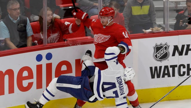 Maple Leafs center Leo Komarov falls next to Red Wings center Gustav Nyquist during the third period of the Wings' 4-2 exhibition loss Friday, Sept. 29, 2017, at Little Caesars Arena.