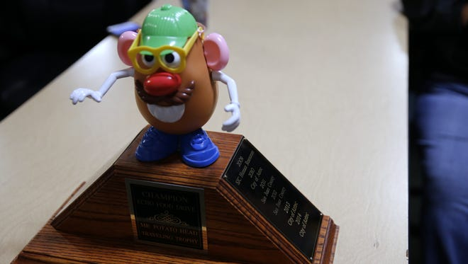 The Mr. Potato Head trophy sits on a table, Wednesday, Nov. 15, 2017, in ECHO Food Bank in Farmington.